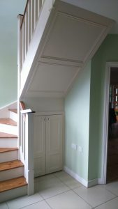 Under stairs storage and paneling by Mark Henshaw Custom Carpentry