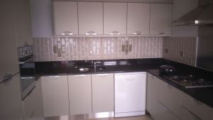 Vinal kitchen stripped and hand painted ,new tiled splash back ,with new stainless steel kicker boards .